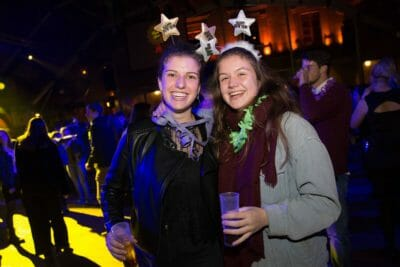Two girls celebrating the New Year's Eve party in Barcelona.