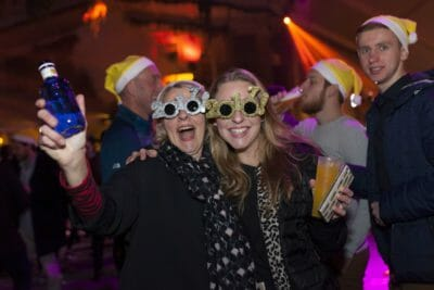 Two friends having a blast at the New Year's Eve party in Barcelona.
