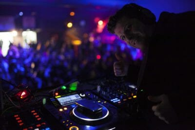 DJ playing the best hits at the New Year's Eve party in Barcelona.